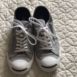 Grey Jack Purcell converse sneakers.
